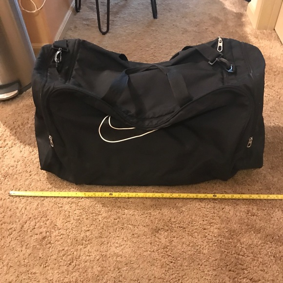 Large black nike duffle bag. M 5bb9018004e33d4e4af49db0 3a7dcb2454